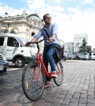 Андре Тан,велосипед,фото,автомобиль,кризис