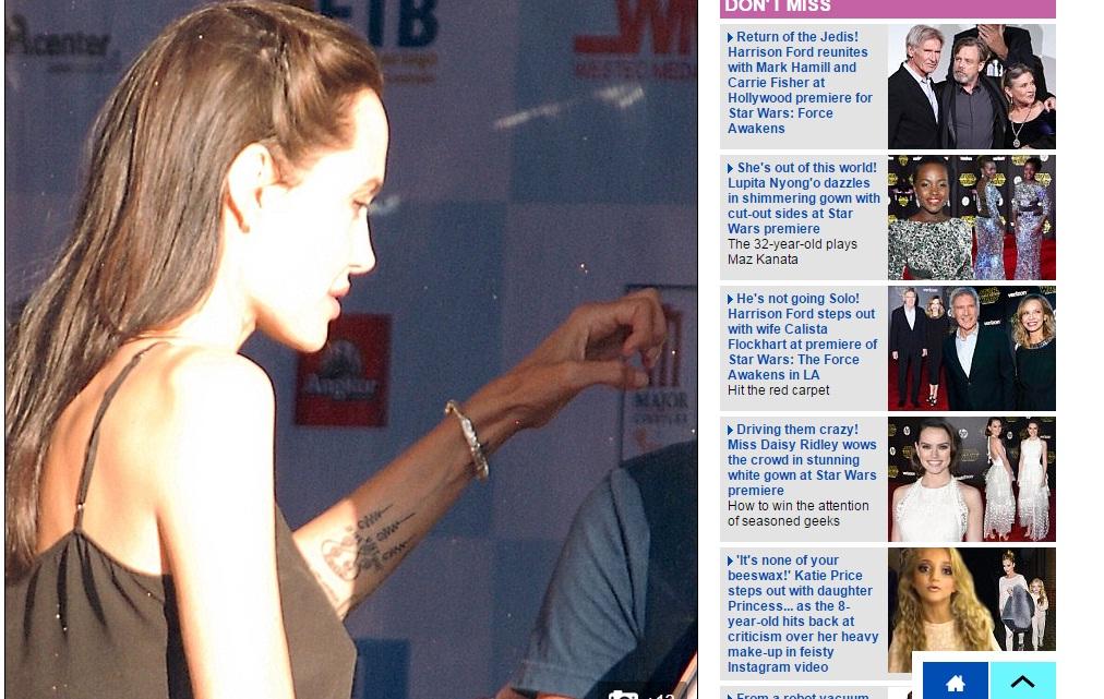 Фотофакт: Анджелина Джоли сделала новую таинственную татуировку