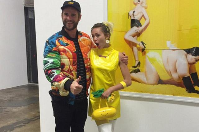 Яркий выход: Майли Сайрус и Лиам Хемсворт вместе посетили популярную выставку