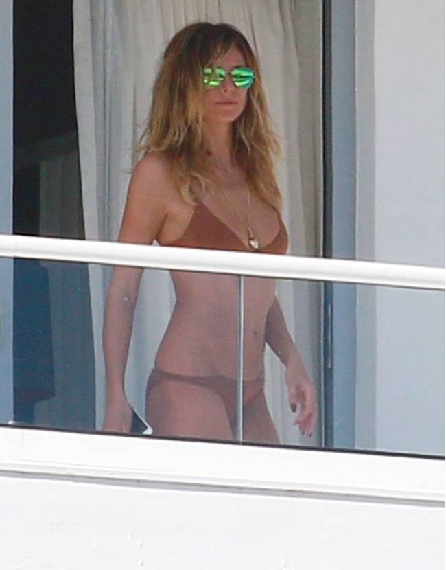 Папарацци сделали горячие кадры Хайди Клум и ее бойфренда в отельном номере